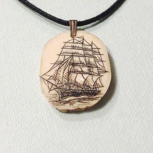 Scrimshaw sailboat necklace
